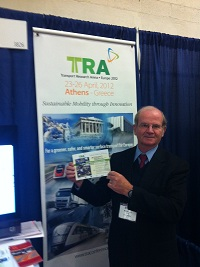 Michel Egger of CEDR in front of the TRA2012 banner at FEHRL's stand